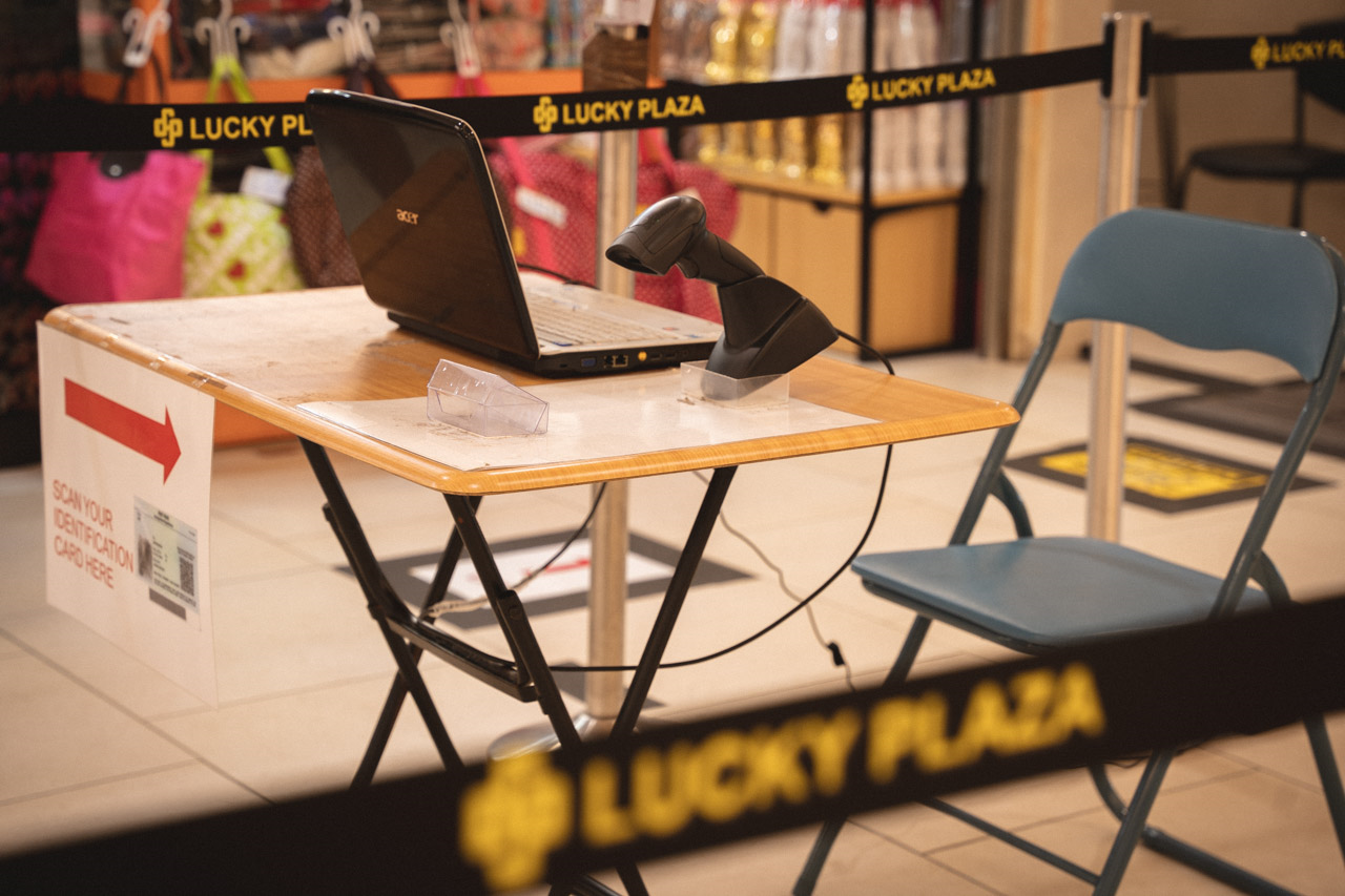 """""""It's A Ghost Town"""": At Lucky Plaza, Hollowed Out By Entry Curbs, A Community Goes Into Crisis"""